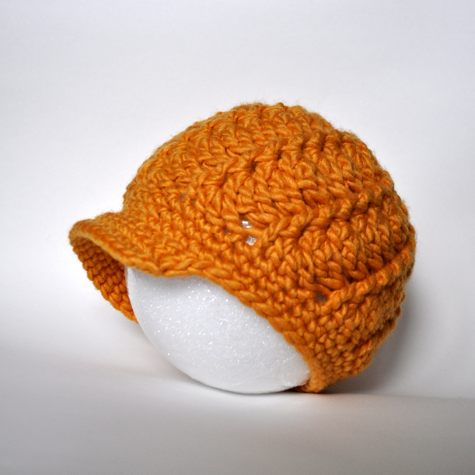 Crochet Baby Hat With Bill Pattern : Free Pattern: Crochet Women s Swirly Brimmed Hat Classy ...